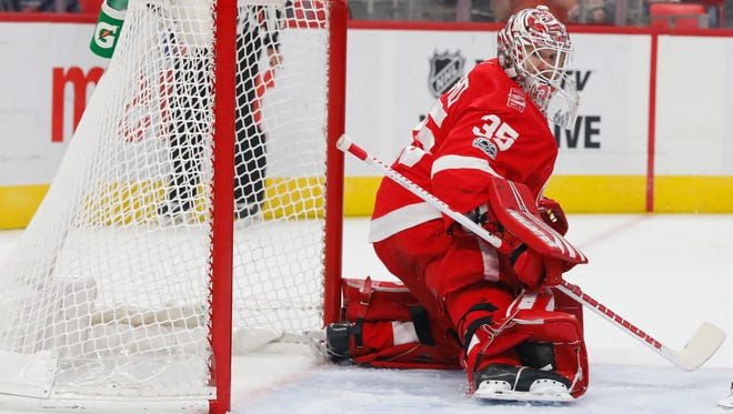 Red Wings goalie Jimmy Howard (35) makes the save in the first period on Tuesday, Oct. 31, 2017, at Little Caesars Arena.