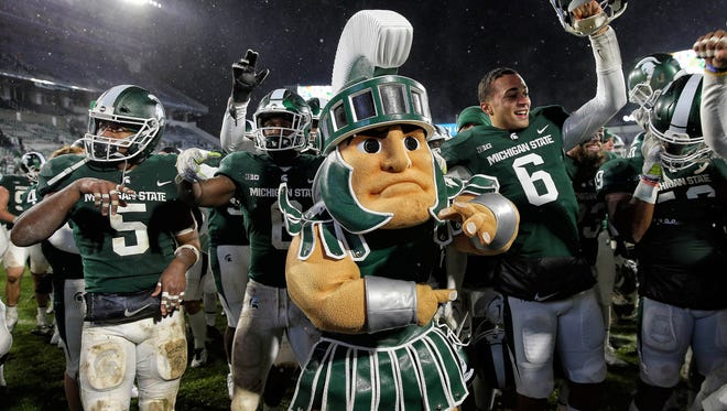 Michigan State Spartans celebrate a win against the Maryland Terrapins after the game against Maryland on Saturday, Nov. 18, 2017, at Spartan Stadium.