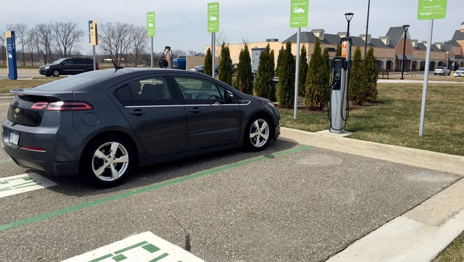 Sarah and Craig Middlebrook, of Jackson, use a charging station for their Chevrolet Volt at Tanger Outlet in Howell on a Sunday afternoon, April 9, 2017.