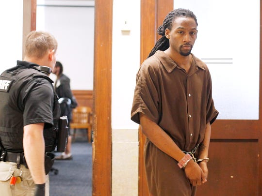 Nathaniel Dixon leaves a courtroom at the Buncombe