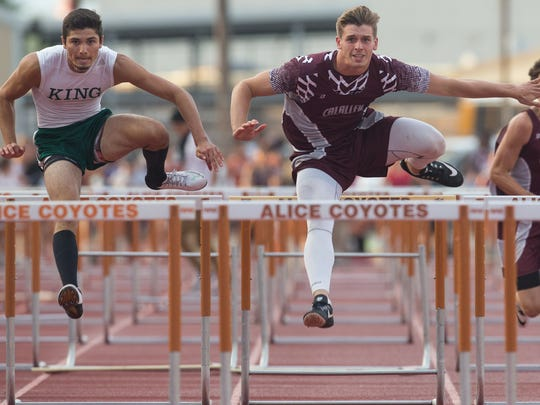 King's Leonel Elizondo and Calallen's Jackson Lanham boy's 110 meter hurdles race during the district 30-5A track meet at Alice Memorial Stadium in Alice on Wednesday, April 12, 2017.