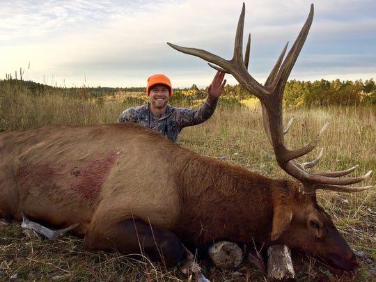 Jordan Miller, 28 of Sioux Falls, poses with an elk