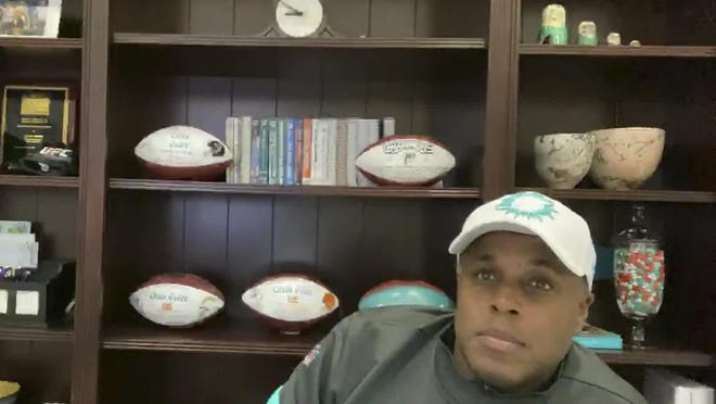 In this still image from video provided by the NFL, Miami Dolphins general manager Chris Grier appears during the NFL football draft Thursday, April 23, 2020.