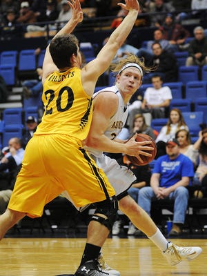 Augustana's Dan Jansen looks for a way around Wayne State's Jordan Holdsworth (20) during Monday night's game at the Arena.