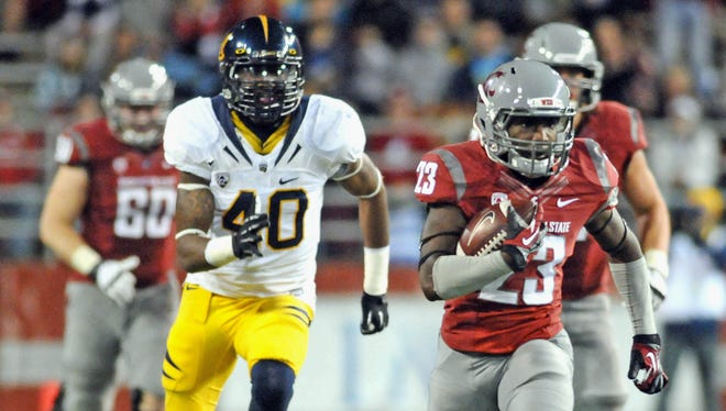 Cal defensive end Chris McCain (40) chases Washington State running back Leon Brooks (23) during a 2012 game in Pullman, Wash.
