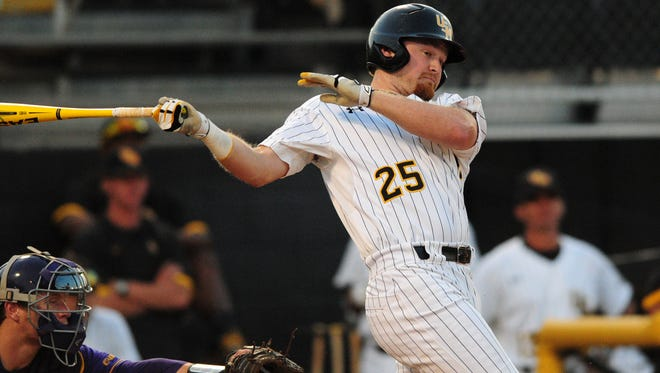 Southern Miss' Mason Robbins (25) hits a foul ball Wednesday night as the Golden Eagles face East Carolina in the opening round of the Conference USA baseball tournament at Pete Taylor Park.