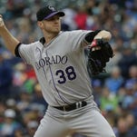 Colorado Rockies starting pitcher Kyle Kendrick throws against the Seattle Mariners during a baseball game, Sunday, in Seattle.