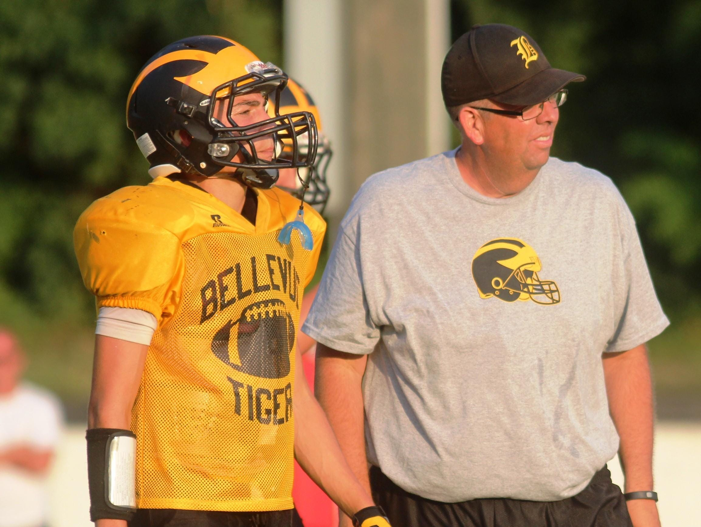 Bellevue head coach Woody McMillen watches the scrimmage.