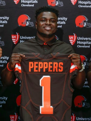 Cleveland Browns' Jabrill Peppers poses for a photo during a news conference at the NFL team's training facility, Friday, April 28, 2017, in Berea, Ohio.