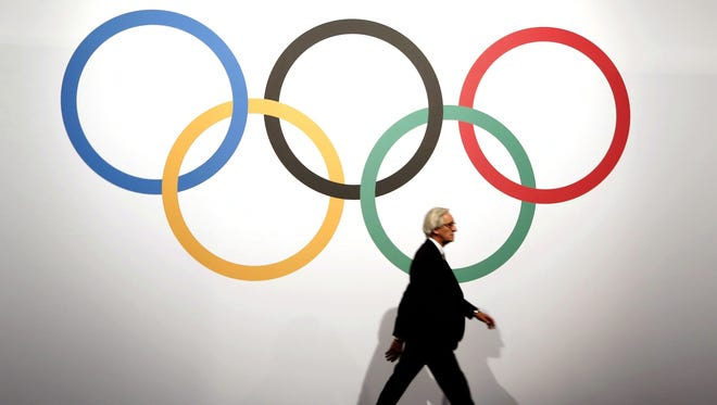 A man arrives on December 8, 2014 for the 127th International Olympic Committee (IOC) extraordinary session in Monaco.