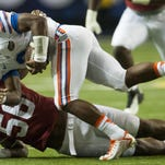 Florida quarterback Treon Harris (3) is brought down by Alabama linebacker Tim Williams (56) in the SEC Championship Game in Atlanta, Ga. on Saturday December 5, 2015. (Mickey Welsh / Montgomery Advertiser)