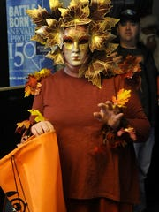 Nikki Lynch dressed as the apple-throwing tree from