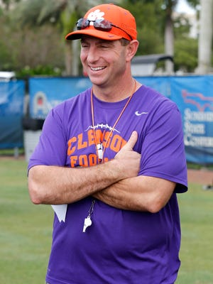 Clemson head coach Dabo Swinney looks on during  his team's practice gearing up for the Orange Bowl.
