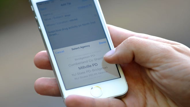 Users can annonymously report crime tips to local law enforcement agencies using the new smartphone app developed for the Cumberland County Prosecutor's Office, seen on an iPhone, Monday, Nov. 16 in Vineland.