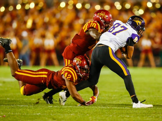 Iowa State linebacker Marcel Spears Jr. (42) and defensive back Brian Peavy (10) bring down Northern Iowa wide receiver JalenRima (87) during the second half Saturday, Sept. 2, 2017, at Jack Trice Stadium in Ames, Iowa. ISU defeated UNI 42-24.