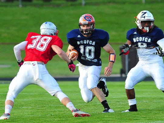 South running back Mason Galco of Lucas looks to get