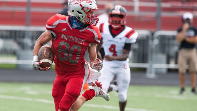 Northwest's Braden Mick looks back at the defenders behind him as he runs toward the end zone for a touchdown reception during the Indians' Week 1 win at Orrville.