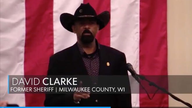 Former Milwaukee County Sheriff David A. Clarke Jr. rallying support for Alabama GOP candidate Roy Moore in Midland City, Al, on Monday December 11, 2017. Framegrab from Montgomery Advertiser video