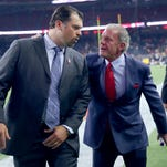 Ryan Grigson, left, general manager for the Indianapolis Colts and team owner and CEO Jim Orsay walk off the field before the start of an NFL football game Thursday, Oct. 8, 2015, at NRG Stadium in Houston, Texas. The Colts won the game, 27-20.