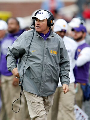 LSU head coach Les Miles calls to his team in the second half of an NCAA college football game against Mississippi, in Oxford, Miss., Saturday, Nov. 21, 2015. (AP Photo/Rogelio V. Solis)