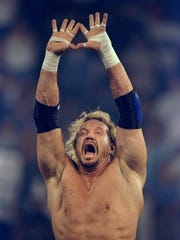 Diamond Dallas Page makes his trademark Diamond Cutter