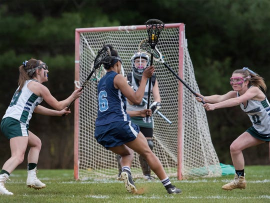 Freehold Township's Cai Martin looks for an opening as she drives towards the goal during first half action. Freehold Township Girls Lacrosse vs Colts Neck in Colts Neck, NJ on April 24, 2018.