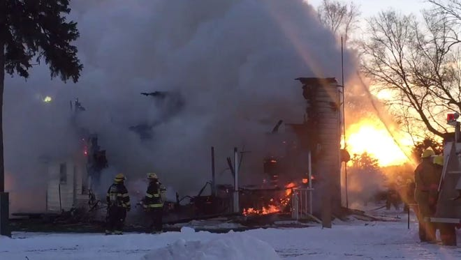 Units respond to a house fire in rural Dell Rapids on Tuesday morning.