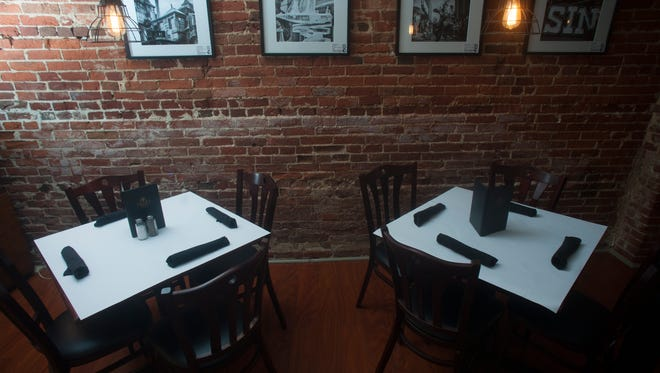 Brick walls are a fixture of The Local Eatery and Pub in Mount Holly.