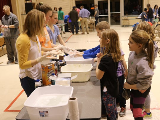 "Immaculate Conception hosted its fourth annual ""Science Night,"" where PCHS students guide elementary students at ICS through fun science experiments."