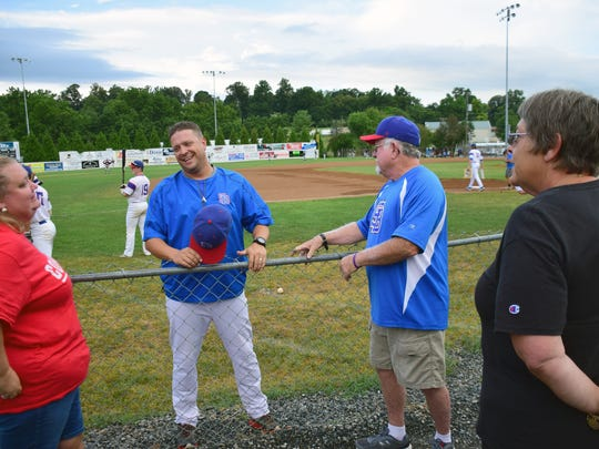 Staunton Braves Head Coach Nolan Neiman shares a laugh with, from left, Candice Martin,  Rowland Hermanson and Kathy Martin, all of whom hosted Braves platers this summer, before the Braves' Valley Baseball League game against the New Market Rebels on Sunday, July 22, 2018, at John Moxie Memorial Stadium in Staunton, Va. The team honored the host families in a pregame ceremony.