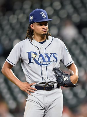 Tampa Bay Rays' Chris Archer reacts after giving up a base hit against the Baltimore Orioles in the fourth inning of a baseball game, Friday, July 27, 2018, in Baltimore. (AP Photo/Gail Burton)