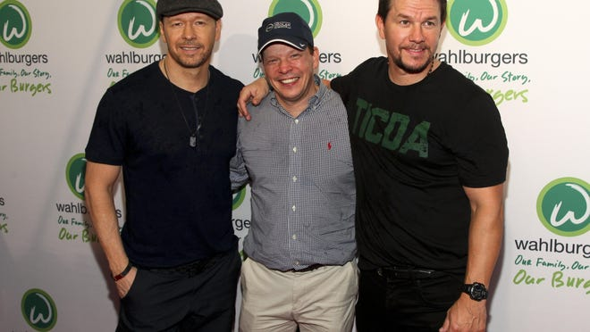 In this June 23, 2015, photo, Donnie Wahlberg, from left, Paul Wahlberg and Mark Wahlberg attend the Wahlburgers Coney Island preview party in New York.
