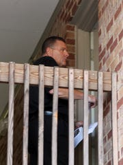 In September 2012, Boone County Sheriff's detective Bruce McVay serves a search warrant on an apartment in the 1700 block of Tanglewood Court, Burlington,  where they arrested David Dooley, 38,  and charged him with Michelle Mockbee's murder.   Mockbee was found murdered at Thermo Fisher Scientific