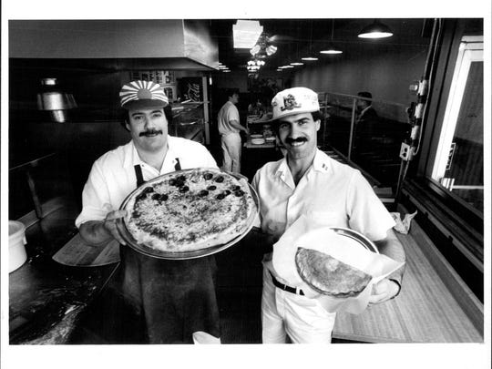 1986 file photo: Joe and Jim Staffieri show their pizza