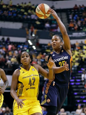 Connecticut Sun's Alyssa Thomas (25) makes a pass against Indiana Fever's Shenise Johnson (42) during the second half of a WNBA basketball game Wednesday, July 13, 2016, in Indianapolis. Connecticut won 86-64.