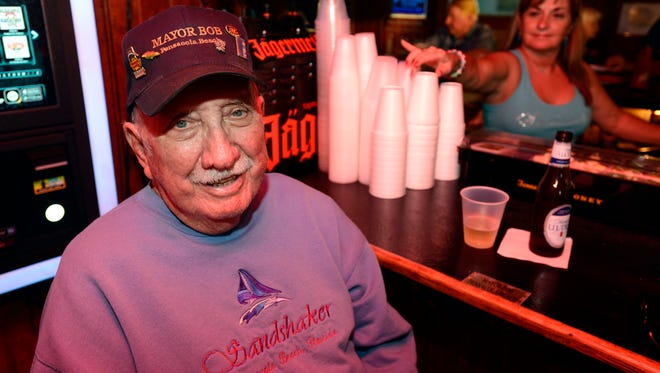 """Bob Merriman, unofficial Pensacola Beach Mayor, said he was given the title years ago by a lady friend who saw him spending so much time at the beach. """"She bought a tag, put it on my car and I've been known as Mayor Bob ever since,"""" Merriman said. Patrons and staff treat Bob like family at the Sandshaker where he has a plaque to mark his seat at the bar."""