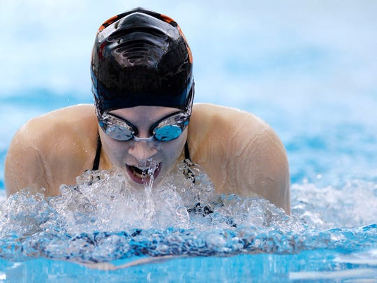 York Suburban's Keelie Walker wins the girls' 100 yard breastroke during the swim meet at Central York High School Thursday, December 17, 2015. York Suburban girls beat Central York 100-80.  Central York boys beat York Suburban 113-70.