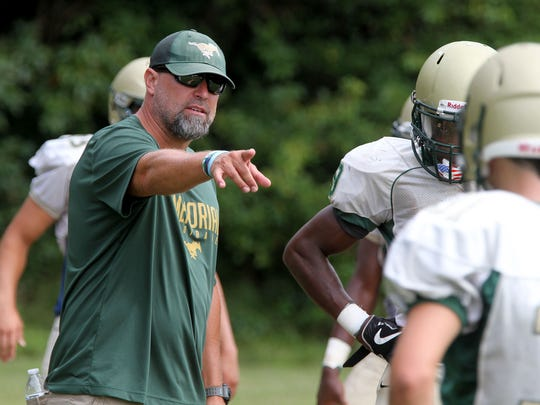 Brick Memorial head coach Walt Currie instructs during a recent practice..