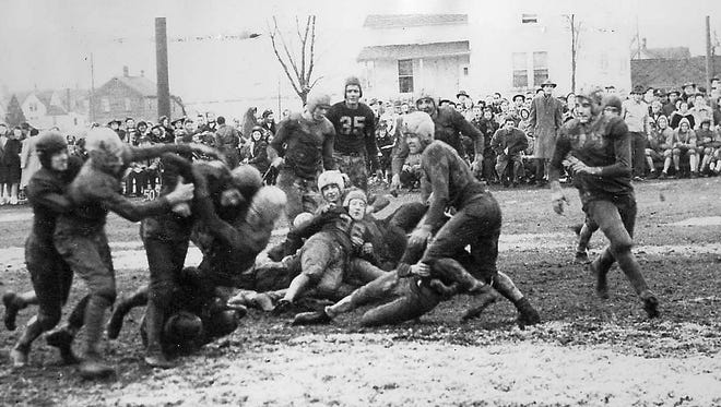 """SNAPSHOT IN TIME: It was 1950 and the """"Z-Bomb"""" put Algoma on the map. He also led his teammates to the greatest football upset of the year. The """"Z-Bomb"""" was Bob Zastrow, known as """"Zug"""" in Algoma. As a junior Midshipman at the U.S. Naval Academy in December 1950, he led his team to a 14-2 victory over Army. One paper called it a """"preposterous upset"""" as Navy had only two other wins that season before beating the country's No. 2 ranked team while his folks, sister, his Algoma girlfriend and President Harry Truman were in the stands. It was said there were few in Algoma who weren't at their radios that Saturday. The New York Times wrote about the redhead from Algoma whose name was plastered in newspapers across the country and Majestic Theater owner Roger Reinert got films of the game to be shown locally. Associated Press called the young quarterback """"The Pride of Algoma,"""" and he was. In another local twist, former Kodan resident Cadet Stanley Kuick played for Army. The football photo, from the 1940s, is from the Heidmann Collection at the Algoma Public Library."""