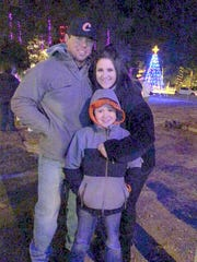 A family bundled up to celebrate Christmas in the Park.