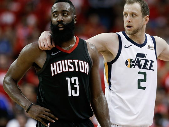 Houston Rockets guard James Harden (13) and Utah Jazz