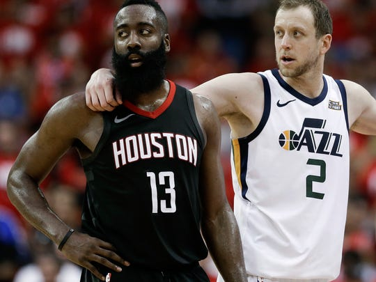 Houston Rockets guard James Harden (13) and Utah Jazz forward Joe Ingles wait during a timeout in the second half in Game 2 of an NBA basketball second-round playoff series, Wednesday, May 2, 2018, in Houston.