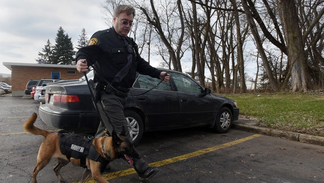 Deputy Rick Torchick and his K-9 Ilka search the parking lot of Chillicothe High School during a 2017 training session.