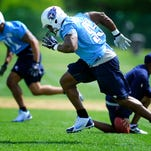 Kamerion Wimbley (95) sprints down field during practice at Saint Thomas Sports Park on Tuesday. Wimbley had played defensive end since joining the Titans but is moving to linebacker in the new defensive scheme.