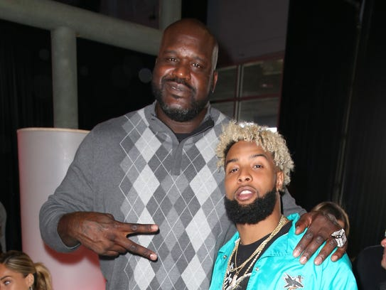 Shaquille O'Neal (L) and Giants wide receiver Odell
