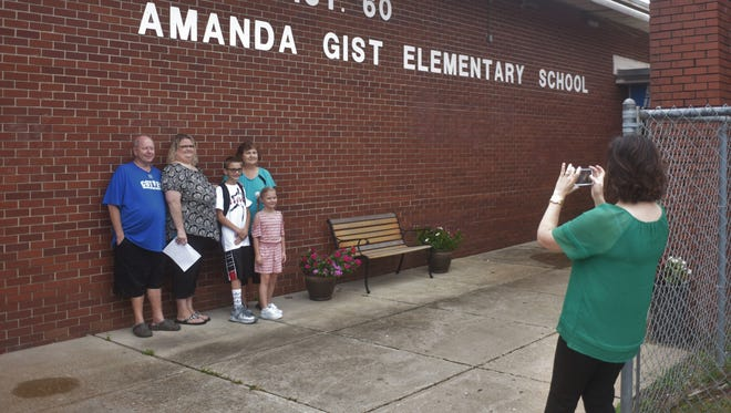 Cotter Superintendent Vanessa Thomas Jones takes a picture of an elementary student and her family Monday morning.