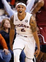 Auburn guard Bryce Brown celebrates after scoring a