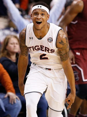 Auburn guard Bryce Brown celebrates after scoring a three-point basket during the first half of an NCAA college basketball game against South Carolina, Saturday, March 3, 2018, in Auburn, Ala.