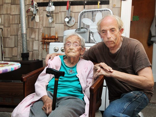 Vivian Rice, 96, and her son, William (Rice), 65, of Covington, were bound with telephone cord and threatened with murder at gun and knife point by two men who forced their way into their home and robbed them.  William Rice has a bruise on his left cheek caused by one of the men striking him.  His wrists were bound so tightly the cord broke the skin and caused bleeding.