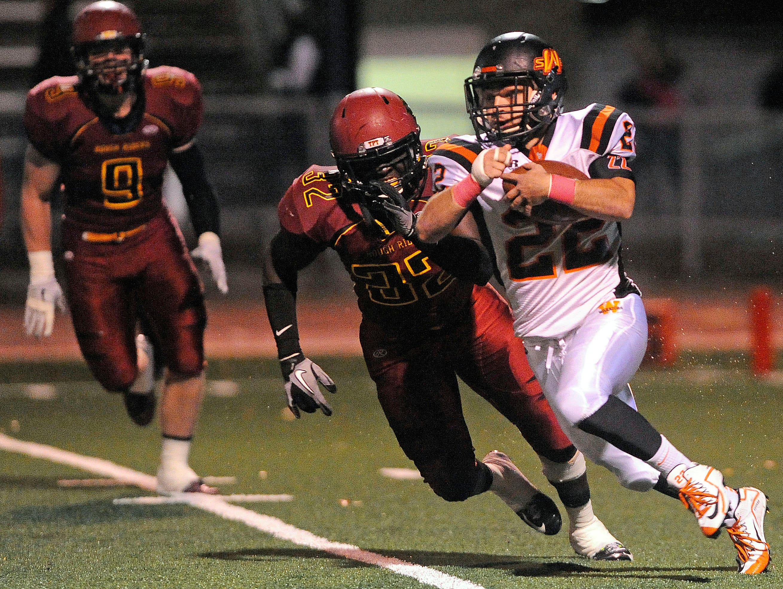 Washington's #22 Chayden Fitzsimmons runs down the field against Roosevelt's #32 Manny Christopher during football action at Howard Wood Field in Sioux Falls, S.D., Thursday, Oct. 22, 2015.